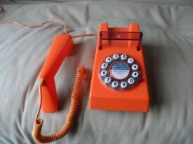 Bright orange push button telephone retro style 1970's