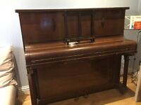 Upright piano old, not tuned, for free.
