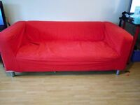 Two red Klippan sofas. (sold together or separate)