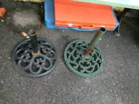 2 garden cast iron umbrella bases.