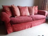 Sofa and matching armchair for sale.