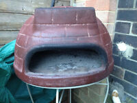Clay pizza oven and pizza blade