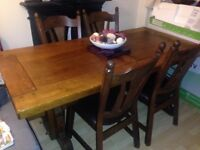 Solid dining room table and chairs