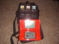 NINTENDO DSI WITH GAMES CHARGER AND CASE