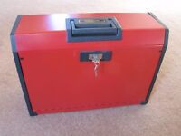 Red, lockable Metal File Box with keys. Good working condition. Expandable front.