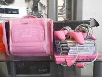 Pink PS2 comes with carry case and 2 controllers and 5 games