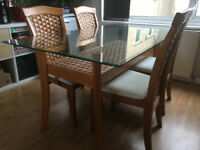 Glass and Wicker Table and 6 Chairs