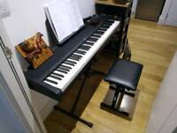Piano, Korg B1 with seat, stand, pedal, headphones and two books