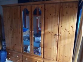 Solid Pine TripleWardrobe,with 6 drawers.Shelves at top of wardrobe.90inchW x 90inch H, 30inch depth