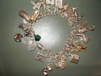 silver charm bracelet with over 20 charms