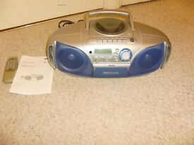 Radio / CD player, complete with instructions and remote control