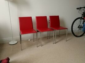 3 Red metal chairs