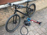 New Carrera mountain bike - used once - disc brakes, soft grips, new helmet and tyre pump wrapped