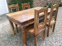 Solid wood dinning table with four chairs for sale