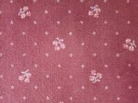 Pink hessian backed carpeting.Used with more wear