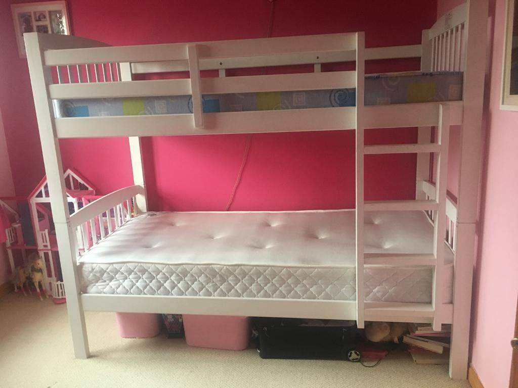 Solid white wooden bunk beds