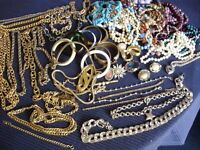 Mixed costumed jewellery: necklaces, bracelets, chains ,brooches, a locket