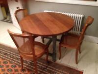 Stylish solid wood dining table and accompanying French chairs