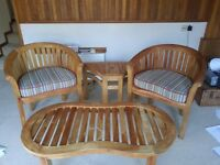 Teak conservatory and patio set, a bench, 2 seats, coffee table and side table with cushions