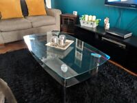 Thick set, heavy glass coffee table