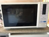 Combination microwave oven including oven and grill. Defrost and baked potato features