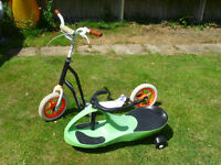 CHILDS PLASMA SIT n RIDE CAR AND A LARGE SCOOTER