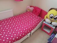 Toddler girls bed with bedside cabinet and 4 draw storage