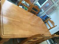 Very solid dining table and 6 chairs
