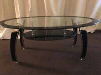 Glass coffee table. 430mm High 600mm wide and 1100mm long. Couple scratches .