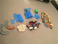 Blue plastic train track, with bridges, sidings, points, and battery operated trains with carriages