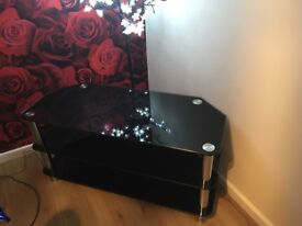 black and chrome TV glass stand