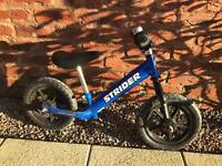 Strider Balance bike. No pedals - encourages learning to ride