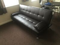 Dark brown leather sofa bed brand new in packaging RRP £229.00