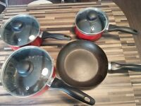 Red pans and frying pans