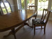 Extending Ducal dining table and 6 chairs