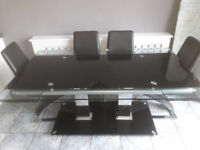 Extending Glass Dining Table complete with 6 Padded Chairs