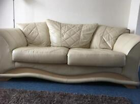 Cream leather sofas