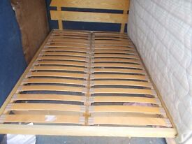 An Ikea double bed frame with double clean mattress