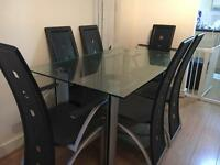 GLASS DINING TABLE WITH 6 CHAIRS , EXCELLENT CONDITION