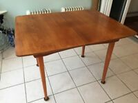 Teak extending dining table