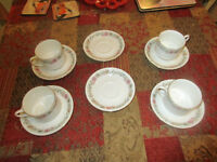 BONE CHINA....4 CUPS AND 6 SAUCERS by PARAGON.....Design is BELINDA.....Absolutely MINT....£25.