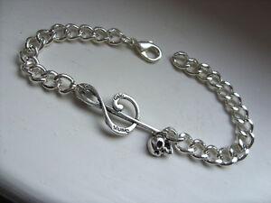 Unusual-Music-Note-Skull-Silver-Curb-Bracelet