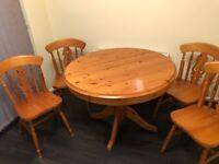 Extendable Solid pine dining room table and 4 chairs