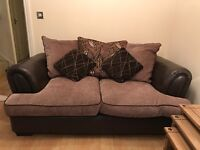 Matching Three & Two seater sofa with scattered cushions. Leather and fabric