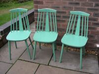 Three attractive wooden chairs with spindle backs.