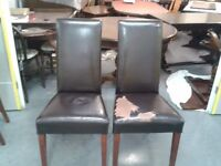 2 faux leather chairs,mahogany,clean but leather broken