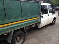 White ford transit crew cab pick up truck