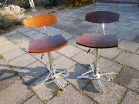 Pair of bar stools. Swivel and height adjustable.