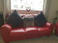 3 and 2 seater sofa. Colour - red. Genuine leather. Great condition
