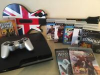 PS3 Console 320GB + Silver Controller + 8 Massive Games inc Uncharted 3 + Guitar + All Leads